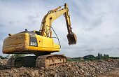 backhoe to excavate the soil on the ground.construction site excavator.wheel loader,backhoe loader,dig the ground