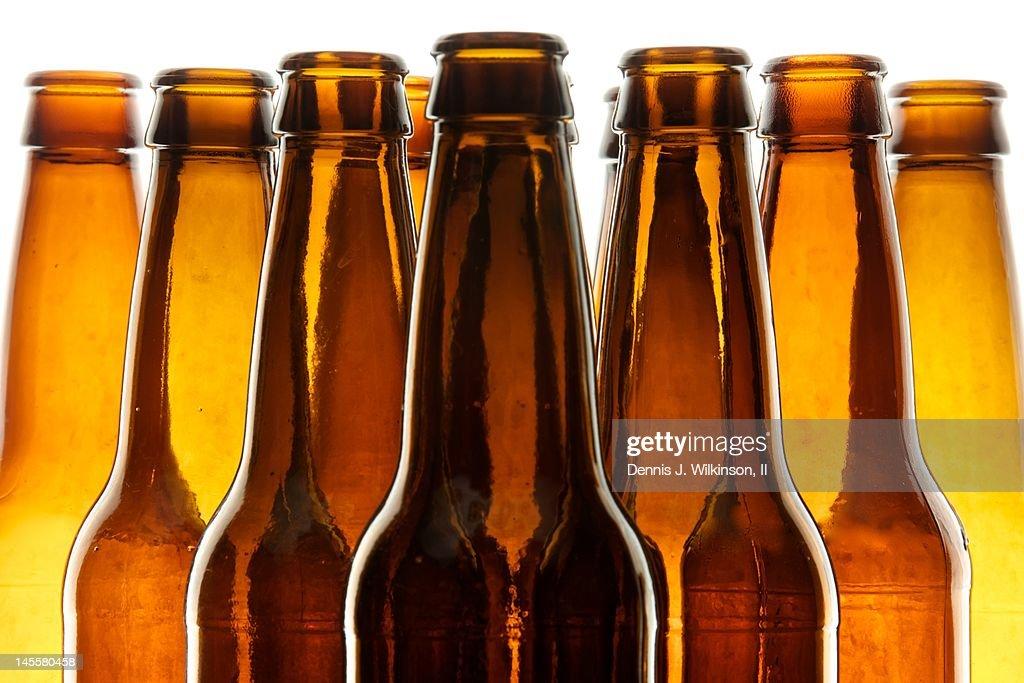 Backlit beer bottles : Stock Photo