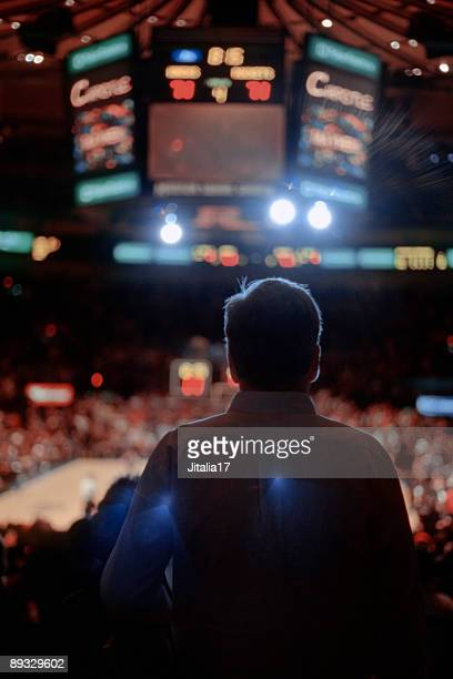 Backlit Man Watching Sporting Event - New York City
