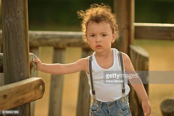 Backlit portrait of a little boy