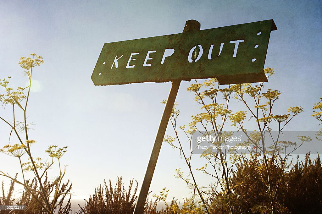 A backlit sign says 'keep out'
