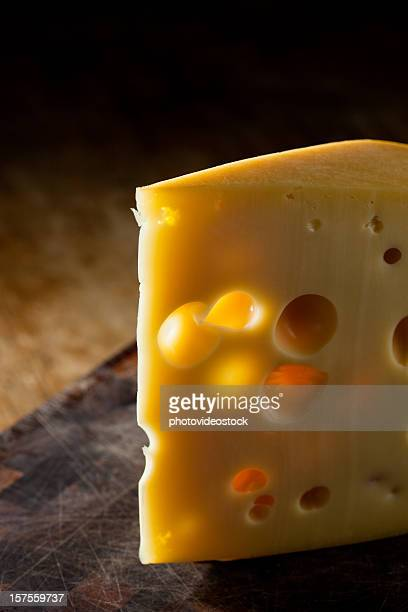 Backlit slice of cheese
