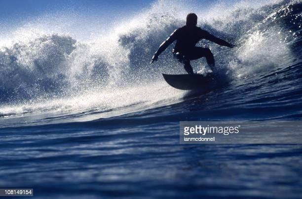 backlit surfer