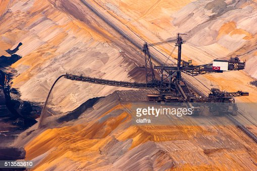 Backloader in quarry : Stock Photo
