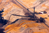A conveyor belt and a very large backloader in a lignite (browncoal) mine, Germany