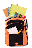 Orange backpack overflowing with various school supplies including notebooks, pens and pencils.  Alternative version of this file shown below: