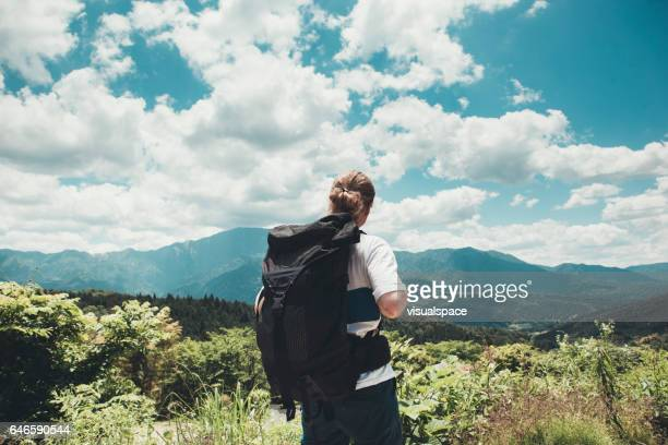 Backpacker Admiring a Scenic View