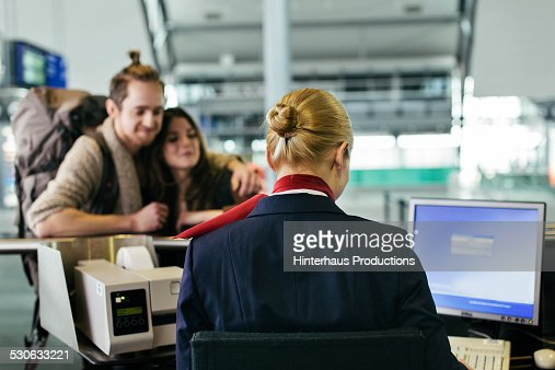 Backpacker Couple At Airline Check-in Counter