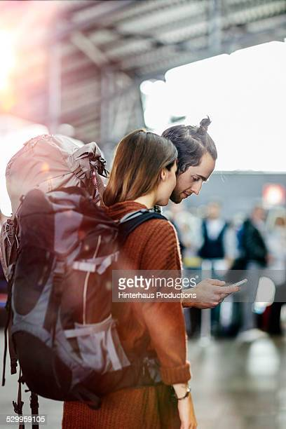 Backpacker Couple At The Airport