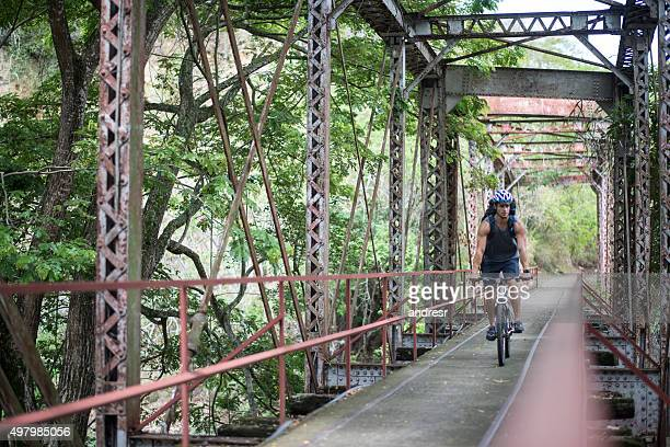 Backpacker cycling outdoors in the countryside