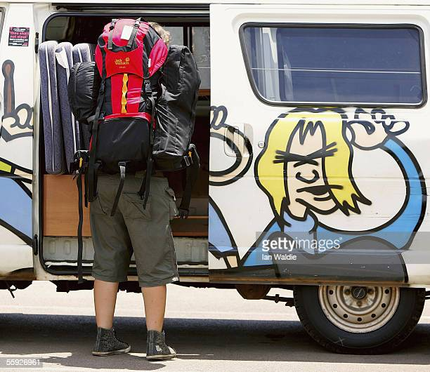 Backpacker Katherine Scheer from Germany loads her backpack into a hired 'Wicked' van before setting off for the outback October 14 2005 in Darwin...