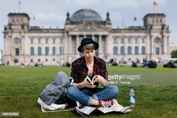 Backpacker Sitting In Front Of Bundestag