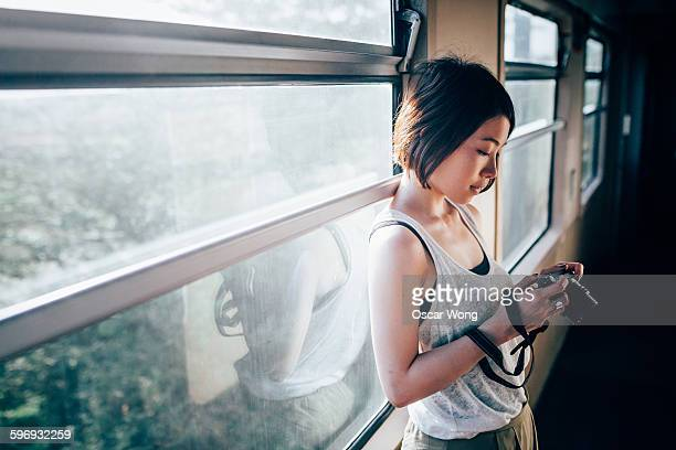 Backpacker traveling on an old train