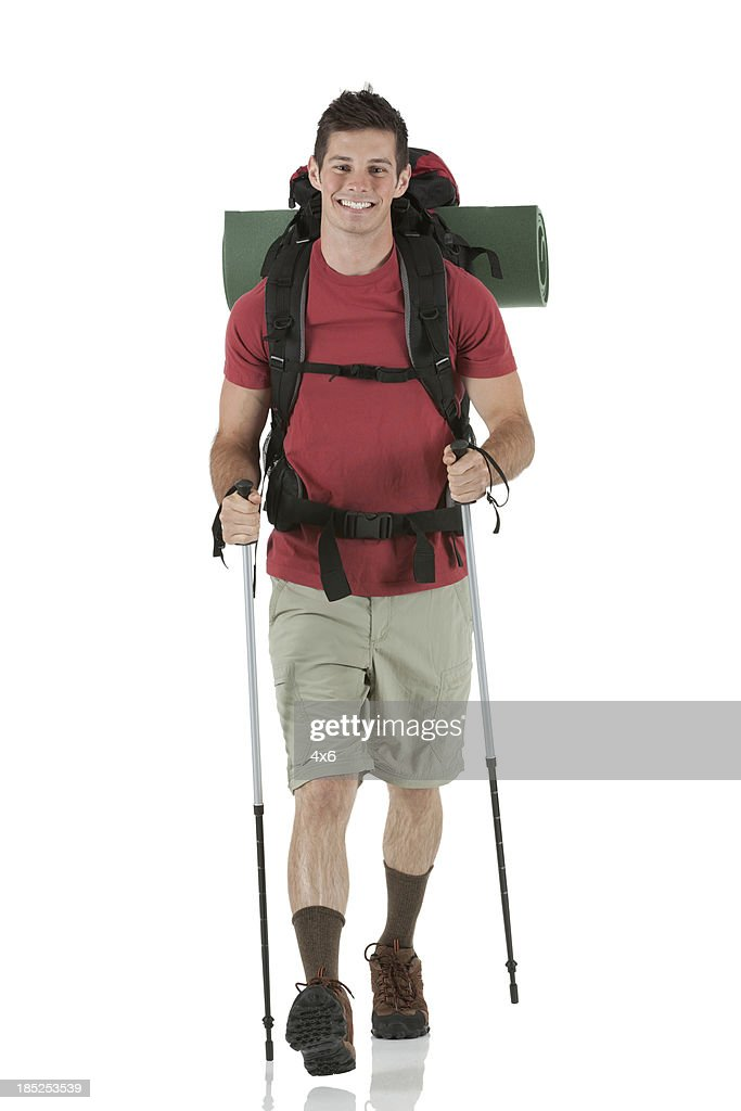 Backpacker trekking with hiking poles