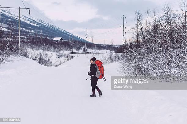 Backpacker walking in snow