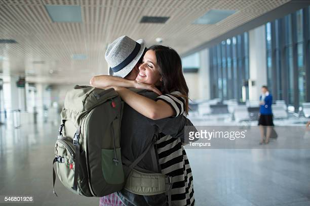 Backpacker welcome hug in the airport.