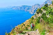 Backpacker with nordic walking at Path of Gods, Amalfi coast, Italy