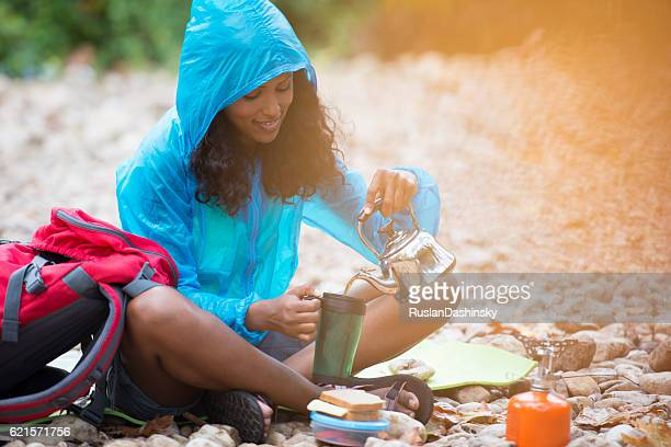 Backpacker woman having lunch break.