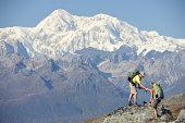 Backpackers hikes Kesugi Ridge Trail in Denali State Park, Alaska.