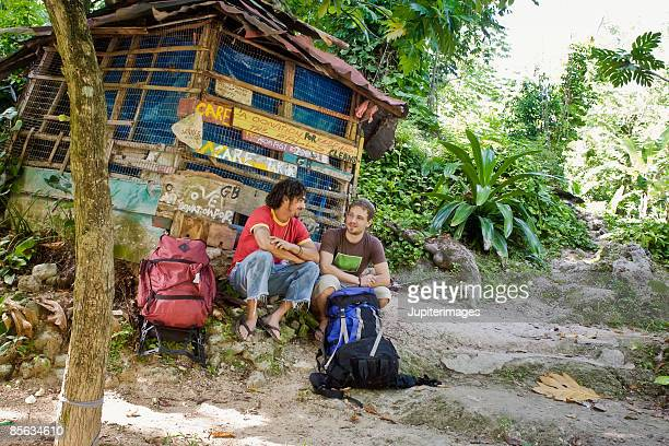 Backpackers in front of shack