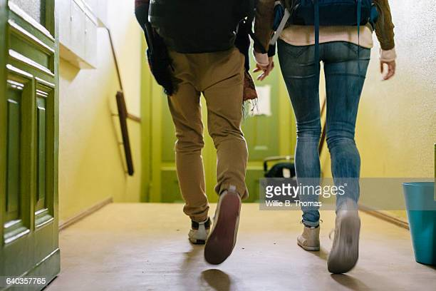 Backpackers walking out of Apartment