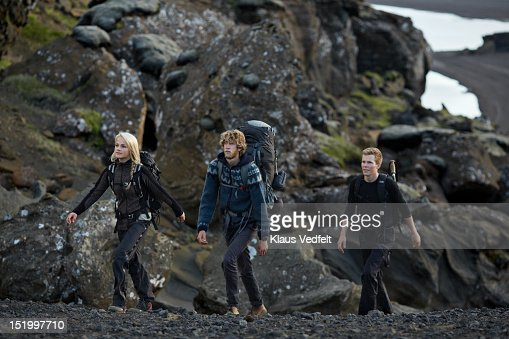 3 backpackers walking threw mountain valley : Stock Photo