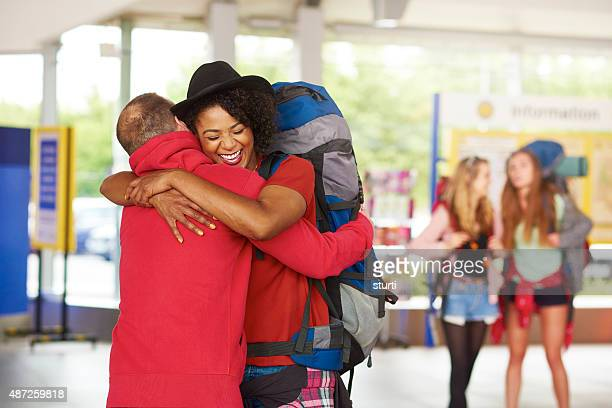 Backpacking friends arrive home to loved ones