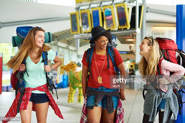 Backpacking friends in terminal building
