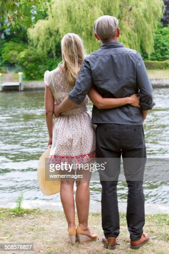 backside of a couple in a park : Stock Photo
