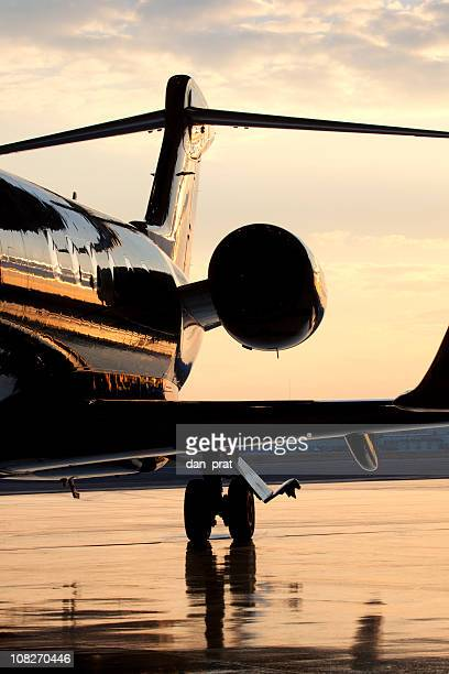 Backside of Private Jet on Tarmac at Dusk