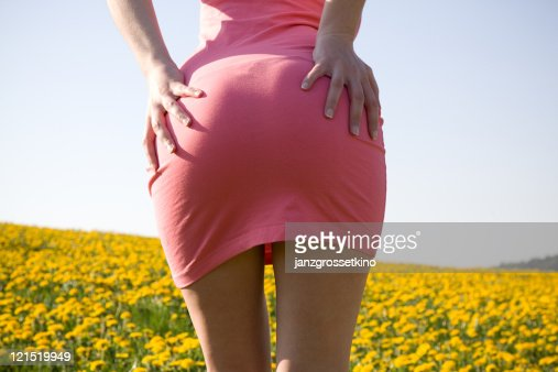 Backside of woman with hands on hips : Stock Photo