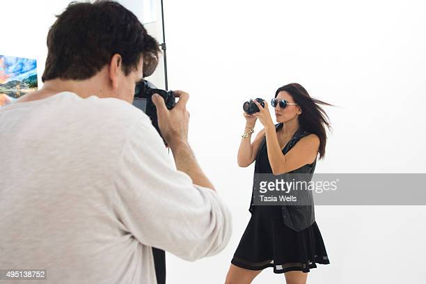 Backstage as photographer Michael Bezjian photographs model Lauren Alvarado with Wildfox sunglasses and a Sony A7R camera at Bel Air Camera on...