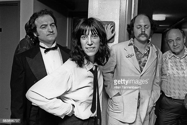 Backstage at Saturday Night Live John Belushi Patti Smith and Arthur Milgrom pose together New York New York April 17 1976
