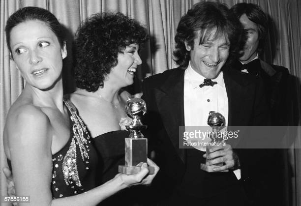 Backstage at the Golden Globes Awards American actress Linda Lavin holds an award trophy and looks to her right at as actress Joyce Dewitt...