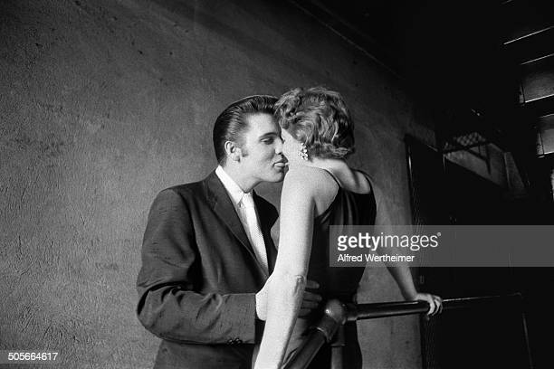 Alfred Wertheimer/Getty Images Backstage at the Mosque Theatre where he was scheduled to perform two shows American musician Elvis Presley kisses...