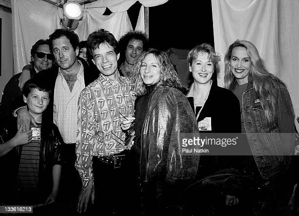 Backstage at the Rolling Stones' 'Steel Wheels' tour British musician Mick Jagger of the Rolling Stones poses with among others actor Michael Douglas...