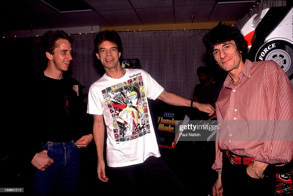 Backstage at the Rolling Stones' 'Steel Wheels' tour, British musicians <a gi-track='captionPersonalityLinkClicked' href=/galleries/search?phrase=Mick+Jagger&family=editorial&specificpeople=201786 ng-click='$event.stopPropagation()'>Mick Jagger</a> (center) and <a gi-track='captionPersonalityLinkClicked' href=/galleries/search?phrase=Ron+Wood+-+Musician&family=editorial&specificpeople=208076 ng-click='$event.stopPropagation()'>Ron Wood</a> (right) of the Rolling Stones poses with American cycling champion <a gi-track='captionPersonalityLinkClicked' href=/galleries/search?phrase=Greg+LeMond&family=editorial&specificpeople=504953 ng-click='$event.stopPropagation()'>Greg LeMond</a>, late 1989.