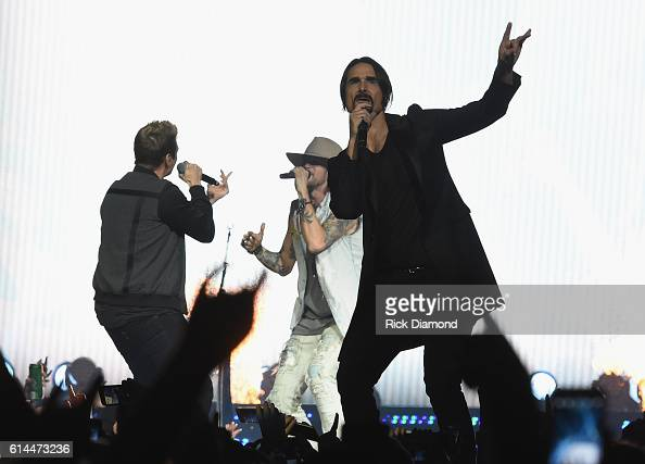 Backstreet Boys Nick Carter and Kevin Richardson joins Brian Kelly of Florida Georgia Line during FGL's Dig Your Roots 2016 Tour at Bridgestone Arena...