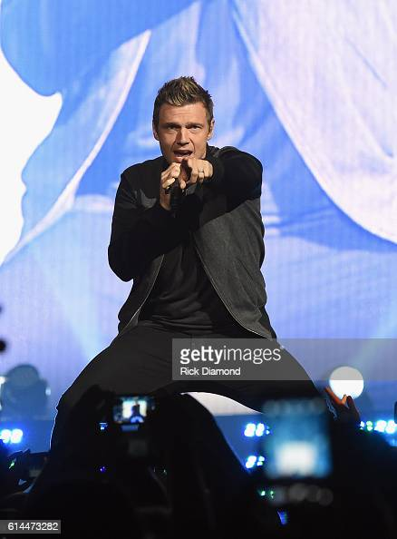 Backstreet Boys Nick Carter joins Florida Georgia Line during FGL's Dig Your Roots 2016 Tour at Bridgestone Arena on October 13 2016 in Nashville...