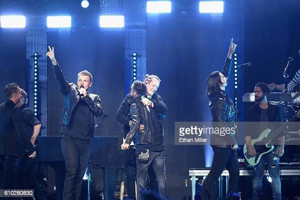 Backstreet Boys perform onstage with Florida Georgia Line at the 2016 iHeartRadio Music Festival at TMobile Arena on September 24 2016 in Las Vegas...