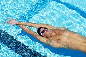 Backstroke, male swimmer pushing off from side