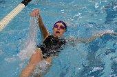 Backstroke swimmer in the pool