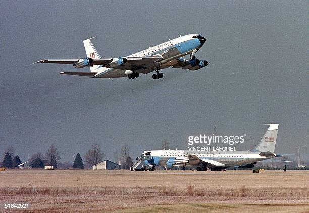 A 'backup' Air Force One takes off from University of Illinois' Willard Airport after the original Air Force One became stuck in the mud when the...