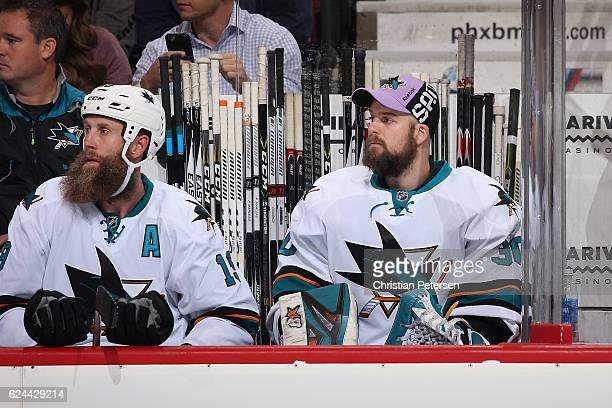 Backup goaltender Aaron Dell of the San Jose Sharks on the bench during the second period of the NHL game against the Arizona Coyotes at Gila River...