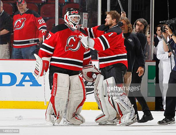 Backup goaltender Johan Hedberg of the New Jersey Devils congratulates teammate Martin Brodeur after the Devils defeated the New York Rangers in Game...