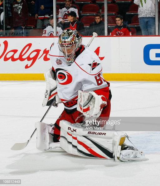 Backup goaltender Justin Peters of the Carolina Hurricanes defends his net during pregame warmups prior to the start of the game against the New...
