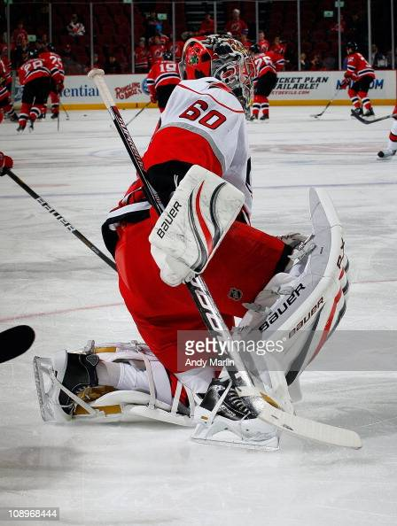 Backup goaltender Justin Peters of the Carolina Hurricanes stretches during pregame warmups prior to the start of the game against the New Jersey...