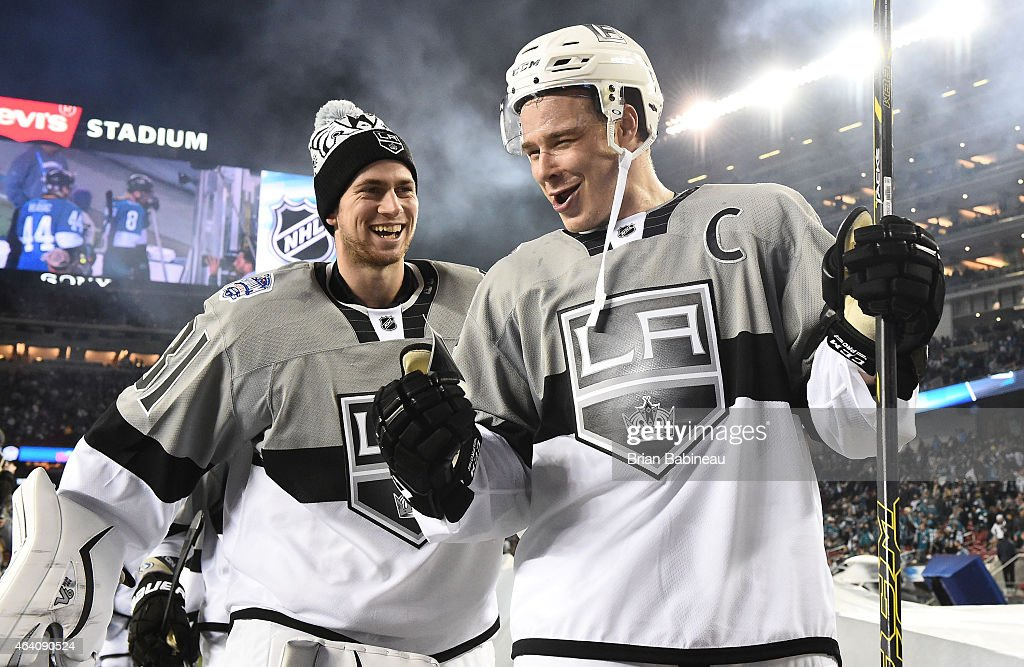 Back-up goaltender <a gi-track='captionPersonalityLinkClicked' href=/galleries/search?phrase=Martin+Jones+-+Ice+Hockey+Player&family=editorial&specificpeople=12318960 ng-click='$event.stopPropagation()'>Martin Jones</a> #31 and <a gi-track='captionPersonalityLinkClicked' href=/galleries/search?phrase=Dustin+Brown+-+Ice+Hockey+Player&family=editorial&specificpeople=4175092 ng-click='$event.stopPropagation()'>Dustin Brown</a> #23 of the Los Angeles Kings smile as they walk back to the locker room after the 2015 Coors Light NHL Stadium Series game between the Los Angeles Kings and the San Jose Sharks at Levi's Stadium on February 21, 2015 in Santa Clara, California. The Kings defeated the Sharks 2-1.