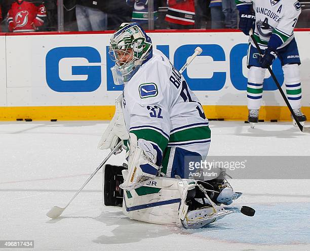 Backup goaltender Richard Bachman of the Vancouver Canucks defends the net during pregame warmups prior to the game against the New Jersey Devils at...