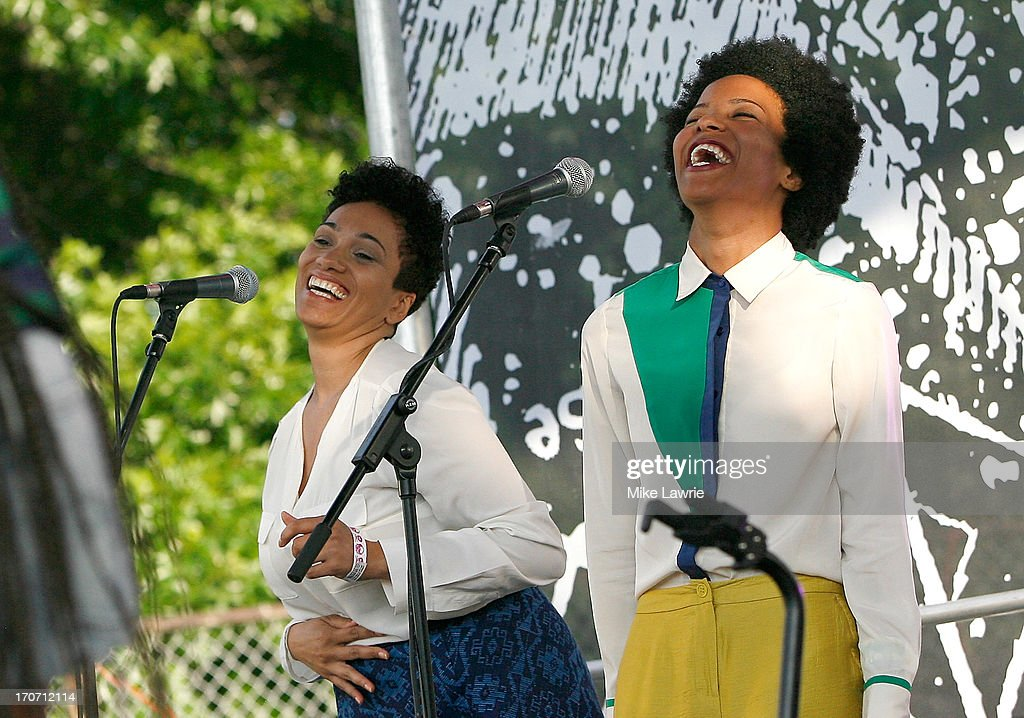 Backup singers perform with Solange during the 2013 Northside Festival at McCarren Park on June 16, 2013 in the Brooklyn borough of New York City.